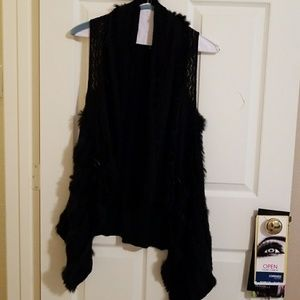 Black vest with fur accents